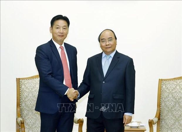 政府总理阮春福会见日本驻越南大使梅田邦夫和永旺集团领导 hinh anh 2