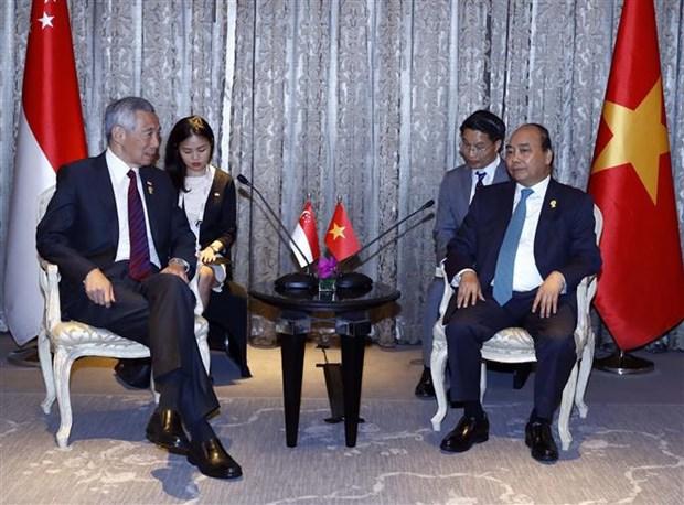 越南政府总理阮春福会见泰国、印尼和新加坡领导人 hinh anh 3