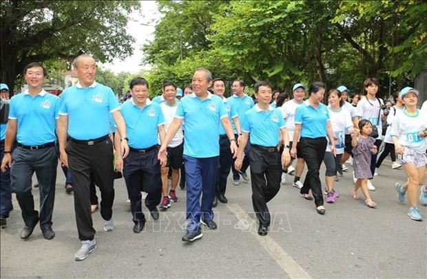 """越南政府常务副总理张和平出席""""健康步行""""活动 hinh anh 2"""