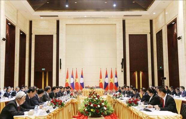 越南政府副总理郑廷勇访问老挝 hinh anh 1