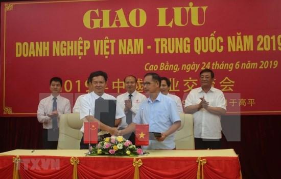 越南高平与中国百色经济区管委会第九次会晤在高平省举行 hinh anh 1