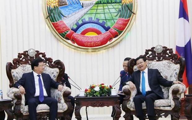 老挝领导人:越老关系向好发展 hinh anh 1