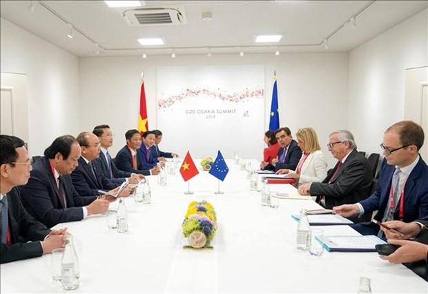 G20峰会:越南政府总理与参会各国领导人和国际组织领导会晤 hinh anh 4