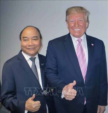 G20峰会:越南政府总理与参会各国领导人和国际组织领导会晤 hinh anh 2