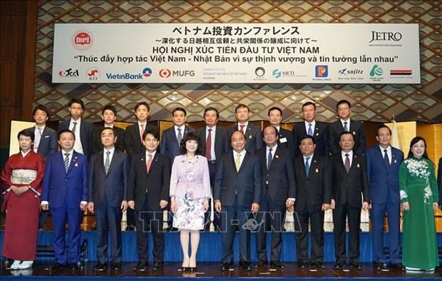 政府总理阮春福主持召开越日投资促进会 见证多项合作文件的签署 hinh anh 1