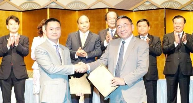 越南国家油气集团和日本JXTG集团签署关于LNG和Gas的合作备忘录 hinh anh 1