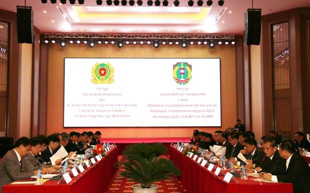 越南与老挝加强犯罪预防打击合作 hinh anh 2