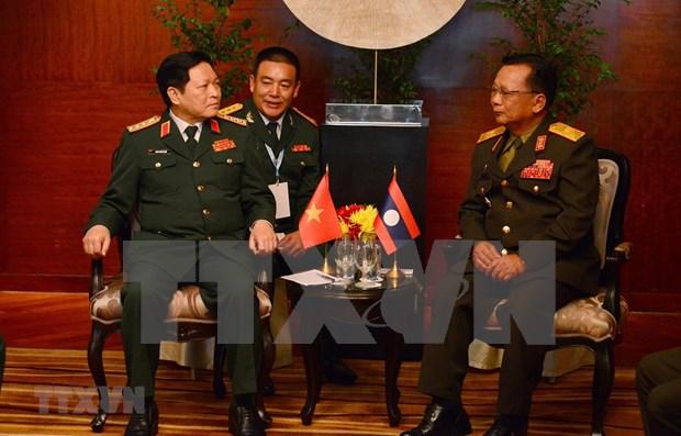 越老防务合作是两国关系中的重要支柱 hinh anh 1