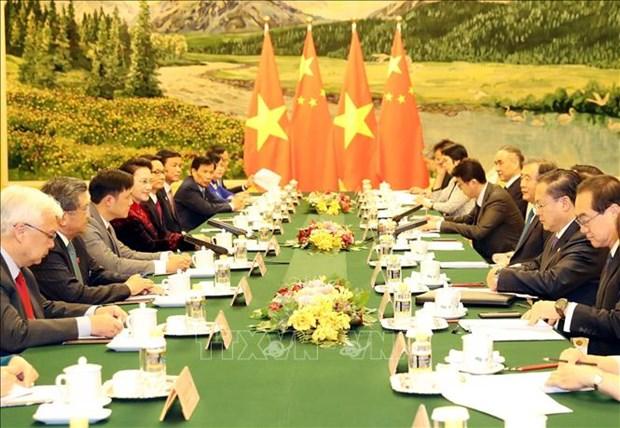 越南国会主席阮氏金银会见中国全国政协主席汪洋 hinh anh 2