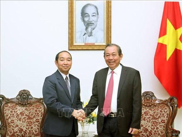 政府常务副总理张和平会见老挝最高人民法院院长坎帕•森达拉 hinh anh 1
