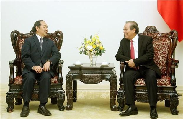 政府常务副总理张和平会见老挝最高人民法院院长坎帕•森达拉 hinh anh 2