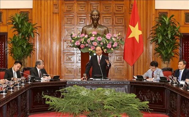 越南政府总理阮春福会见新加坡企业代表团 hinh anh 1