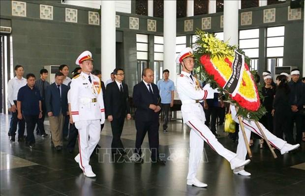 政府总理阮春福出席越南著名数学家黄瘁追悼会 hinh anh 1