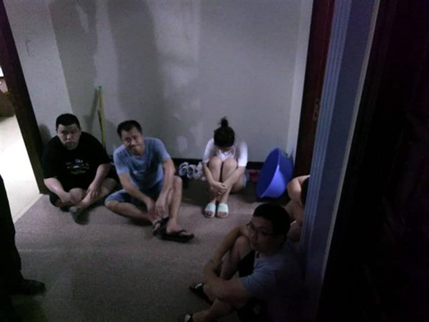 未经许可擅自使用手机信号放大器 5名外国籍人士遭拘留 hinh anh 1
