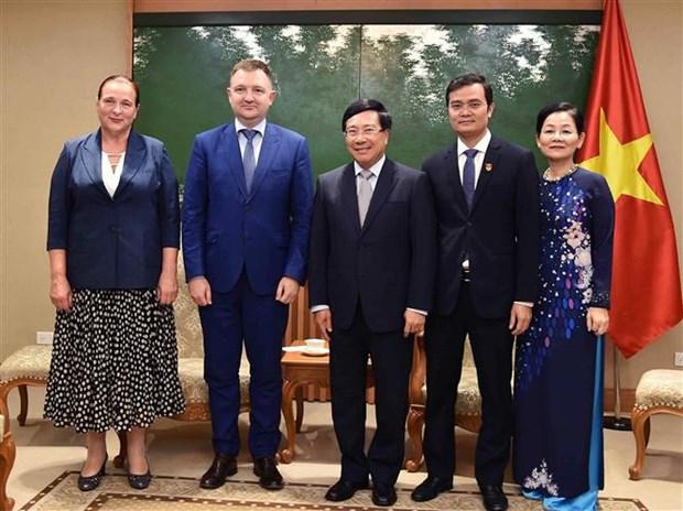 越南政府副总理范平明会见俄罗斯联邦青年事务署署长亚历山大·布加耶夫 hinh anh 1