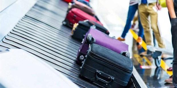 越航乘客的行李将按件计算 乘客将享有更多利益 hinh anh 2