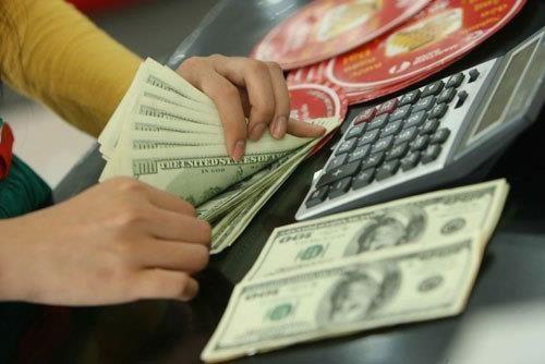 7月24日越盾对美元汇率中间价下调1越盾 hinh anh 1