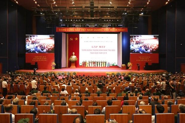 越南举行全国伤残军人先进代表表彰大会 政府总理阮春福等国家领导人出席 hinh anh 1