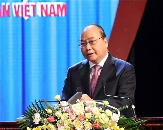 政府总理阮春福:工会组织需履行好保护劳动者合法利益的核心职能 hinh anh 2