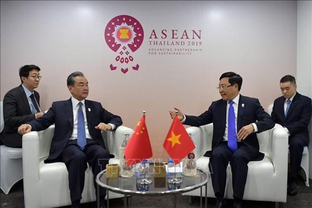 越南政府副总理兼外长范平明会见中国外长王毅 hinh anh 1