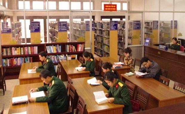越南与老挝加强军队图书馆的合作 hinh anh 1