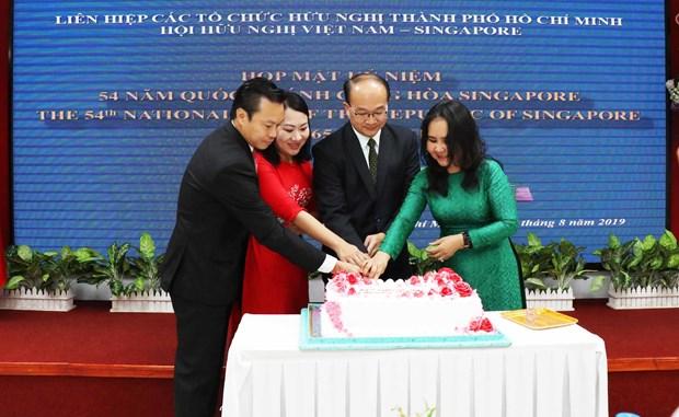 胡志明市愿与新加坡促进友好合作关系 hinh anh 1
