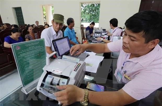 经济学家:美元升值人民币贬值不会对越南盾造成太大的影响 hinh anh 1