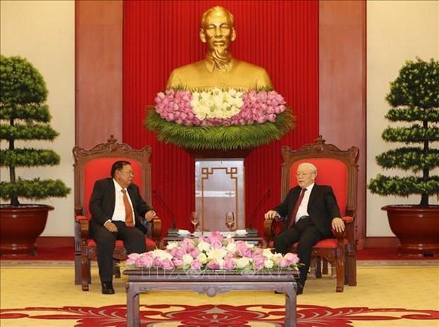 越共中央总书记、国家主席阮富仲会见老挝国家主席本扬·沃拉吉 hinh anh 2