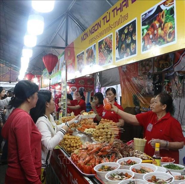 越泰购物与美食展览会在越南后江省举行 hinh anh 2