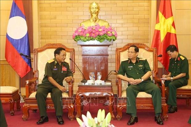 越老两国军队就维护政治安全领域开展经验交流与合作 hinh anh 1