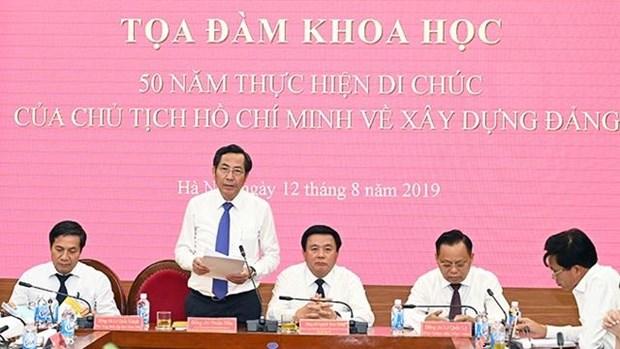 """题为""""胡志明主席关于党建的遗嘱落实50周年""""的学术座谈会在河内举行 hinh anh 1"""