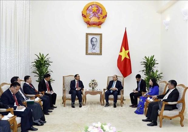 阮春福总理:越南愿同老挝加强监察领域的合作 hinh anh 1