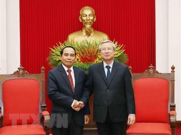 越共中央书记处常务书记陈国旺会见老挝代表团 hinh anh 1