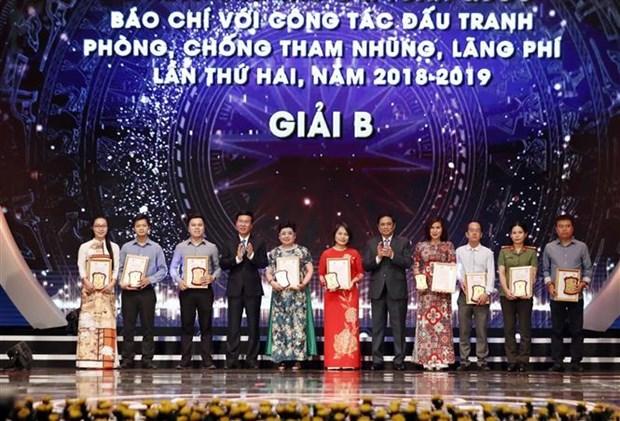 政府总理阮春福:发挥新闻媒体在反腐倡廉工作中的作用 hinh anh 3