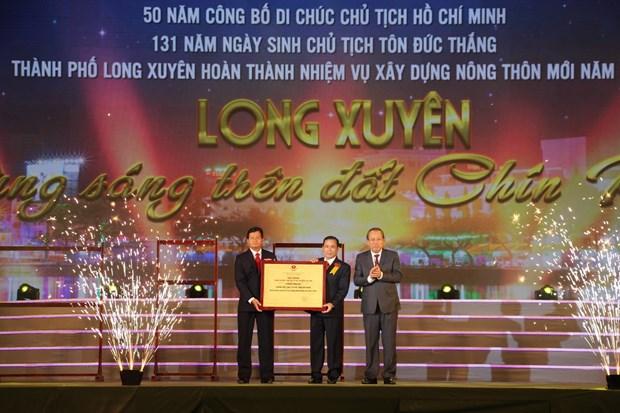 越南政府副总理张和平:将龙川建设成为九龙江平原的示范城市 hinh anh 1