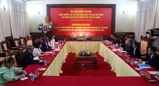 越南国会副主席杜伯巳会见古巴最高人民法院院长 hinh anh 2