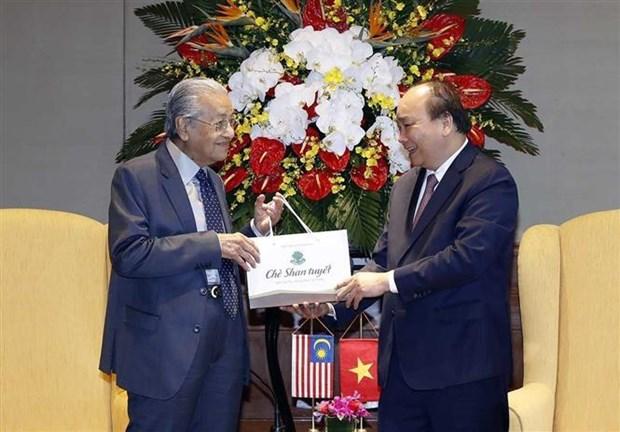 越南与马来西亚发表联合声明 强调进一步加强各领域的合作 hinh anh 2