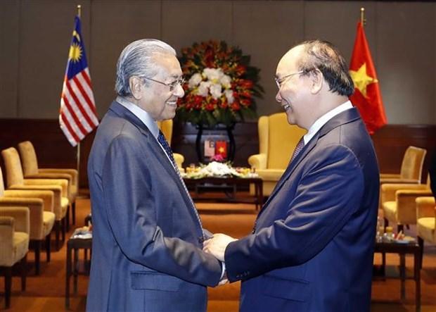 越南与马来西亚发表联合声明 强调进一步加强各领域的合作 hinh anh 3