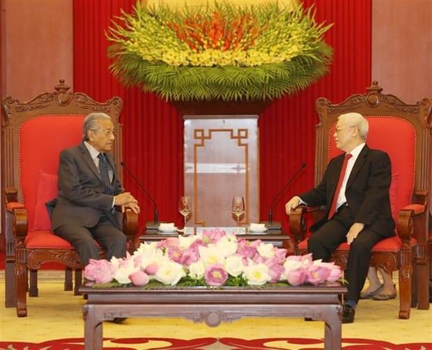 越共中央总书记、国家主席阮富仲会见马来西亚总理马哈蒂尔 hinh anh 2