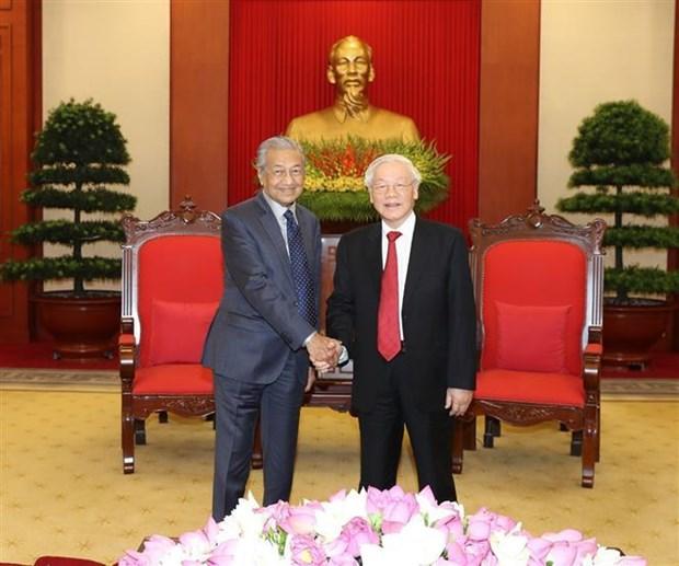越共中央总书记、国家主席阮富仲会见马来西亚总理马哈蒂尔 hinh anh 1
