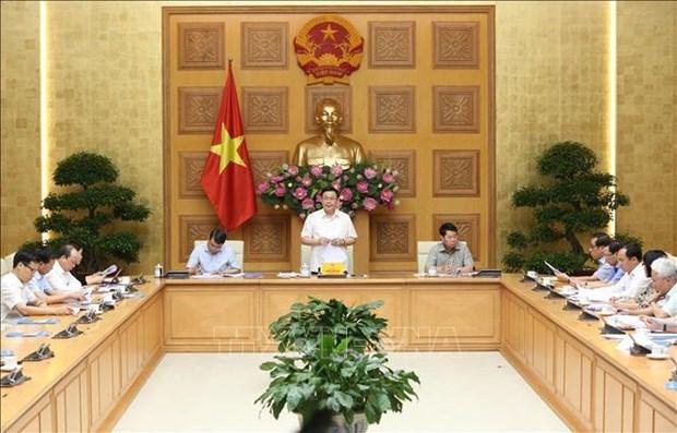 越南政府副总理王廷惠主持反洗钱指导委员会会议 hinh anh 1