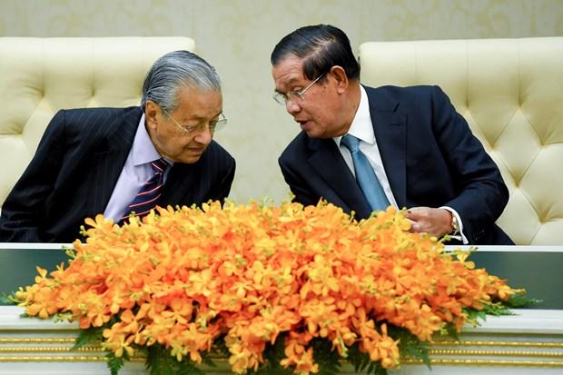 柬埔寨和马来西亚扩大贸易投资与旅游合作 hinh anh 1