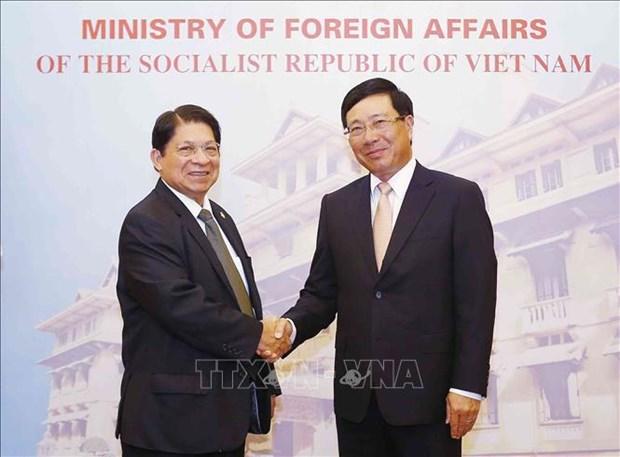 越南政府副总理兼外长范平明与尼加拉瓜外长丹尼斯·孟卡达举行会谈 hinh anh 1