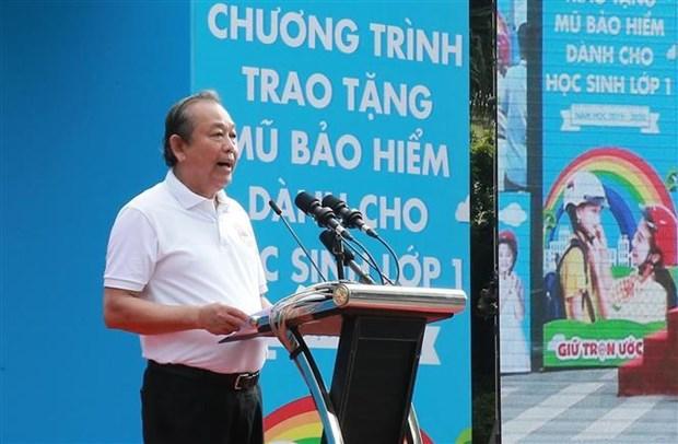 """政府副总理张和平发起""""为儿童佩戴安全头盔""""运动 hinh anh 2"""