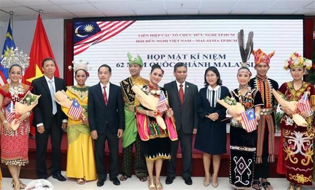 纪念马来西亚国庆62周年见面会在胡志明市举行 hinh anh 1