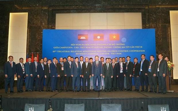 第18届柬老越三国禁毒合作部长级会议在河内举行 hinh anh 1