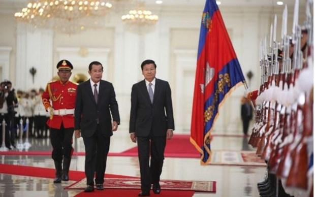 柬埔寨与老挝一致同意把关系提升为长期全面战略伙伴关系 hinh anh 1