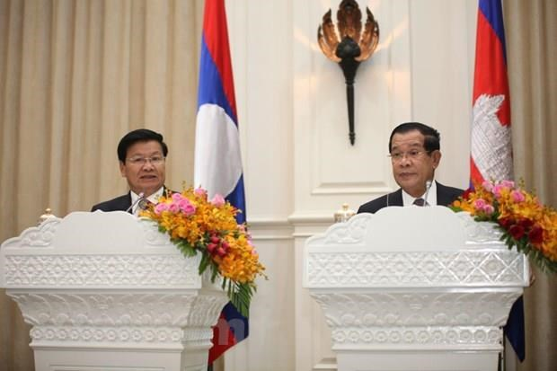柬埔寨与老挝一致同意把关系提升为长期全面战略伙伴关系 hinh anh 2