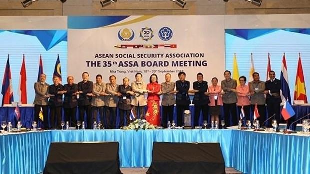 越南在东盟社会民生保障协会主席任期里作出巨大贡献 hinh anh 1