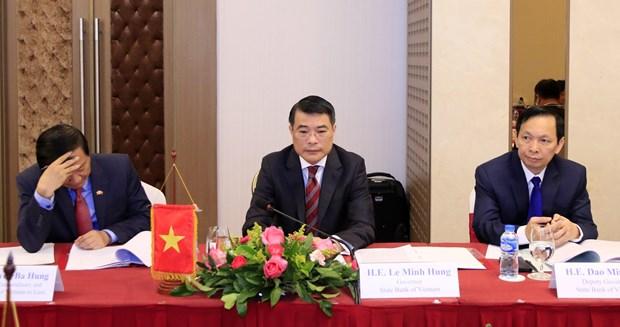 越南国家银行与老挝中央银行加强合作 hinh anh 2